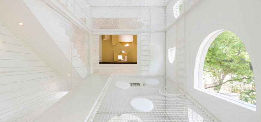 White minimalist home with mesh nets throughout.