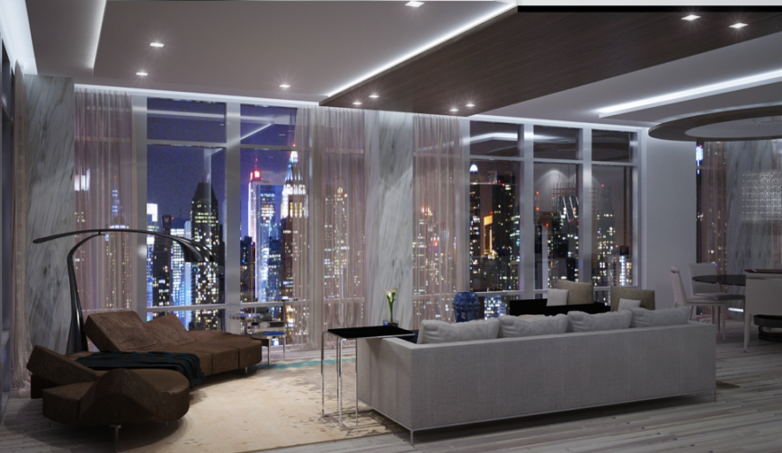 The formal living room has two distinct seating areas; one is an ultra low-profile chocolate brown sectional with a chaise, the other is a contemporary sofa in gray. The floor-to-ceiling windows are covered with sheer drapes with a light pink undertone.