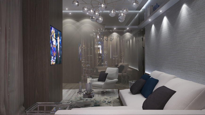 The family room is situated across from a reflective wall that makes the smaller space feel twice as large. The light fixture above the cream sectional has many small mirrored globes. A shelf runs along the top portion of the wall.