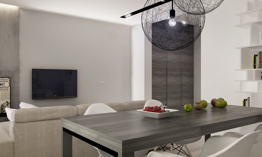 The large, sleek dark wood dining table matches the grey stained hardwood seen elsewhere in the home, including the full height wall panels in the distance here. The wireframe sphere chandeliers add a jolt of contrast and style.