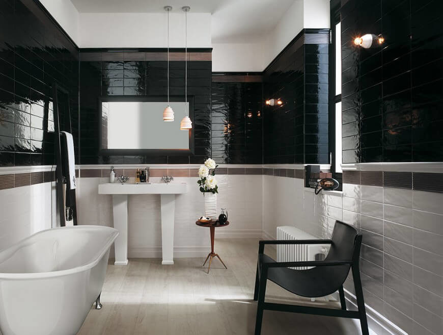 This bathroom is full of polished tile that contrasts elegantly with one another. The light wooden flooring also adds to this fierce color scheme of dark and light hues.