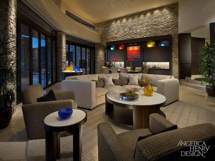 In A Luxurious Contemporary Home, The Stone Walls Are Interrupted By A  Large Wall With