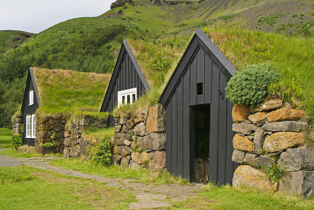 Buildings With Green Roofs on Modern Houses Built Into Hillsides