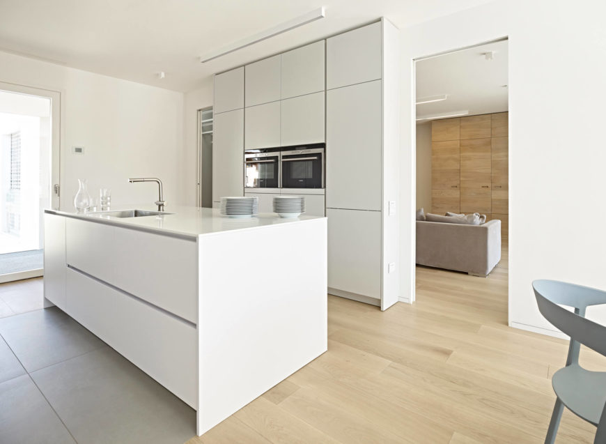 The kitchen and dining area, located just off the living room, follows the streamlined, minimalist design of the rest of the house. The simplified design still leaves plenty of room for entertaining.