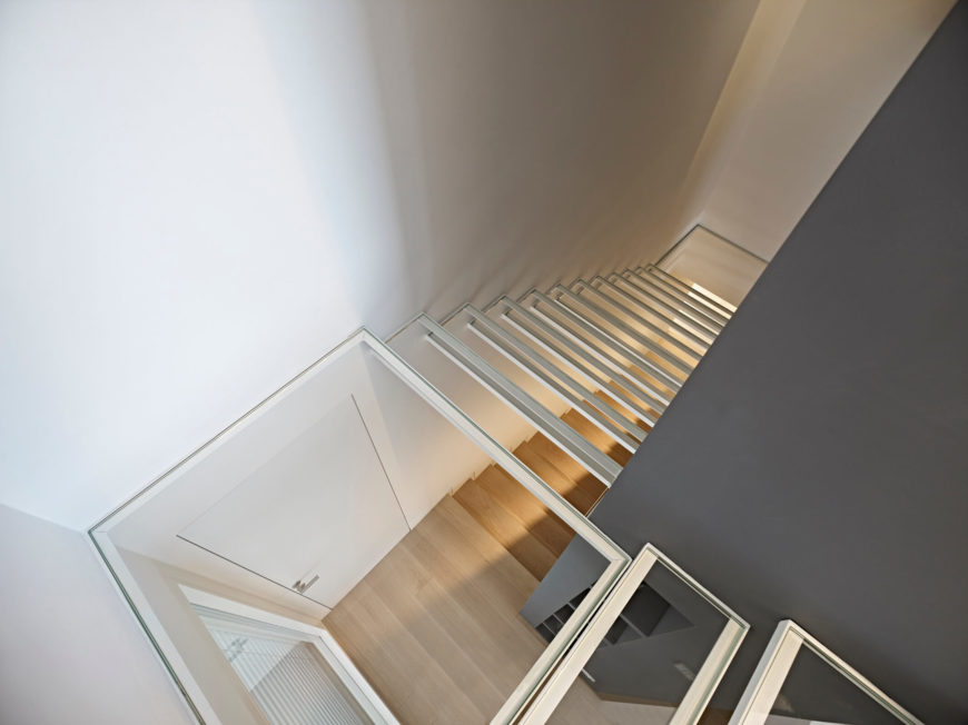 The glass stairs leading up to the small second floor and the veranda offer an interesting view of the lower floors. While different, this is an excellent choice to keep the stairway from becoming too dark and tight in such a small living space.