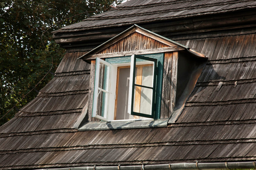 These dark natural wooden shingles have a very antique appearance. This home uses dark and rich cedar shingles that move from left to right as well.