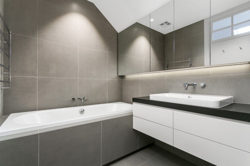 This Minimalistic Bathroom Has A Very Calm And Neutral Color Scheme Large Mirror Move
