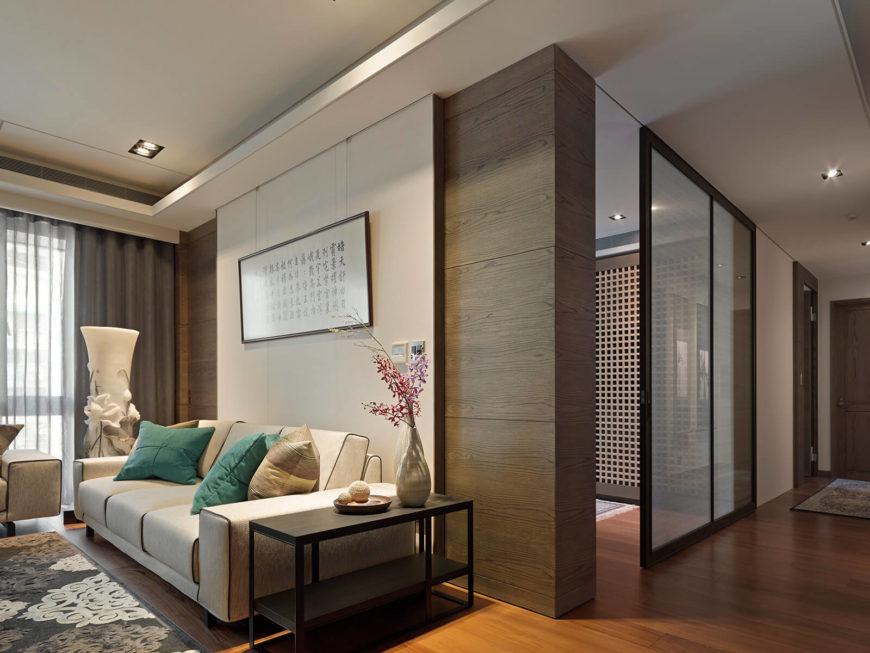 Moving further into the home, we see both a central wall lightly separating the living room and spaces beyond, as well as the transparent sliding panels that close off certain spaces.