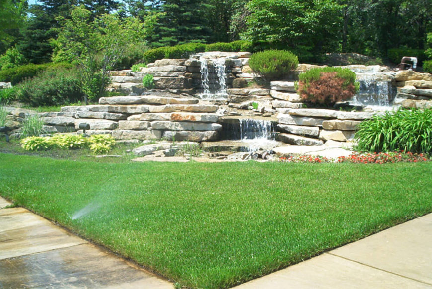 Waterfalls can make the most gorgeous addition to any yard. This waterfall uses beautiful slabs of rock for a wild looking piece.