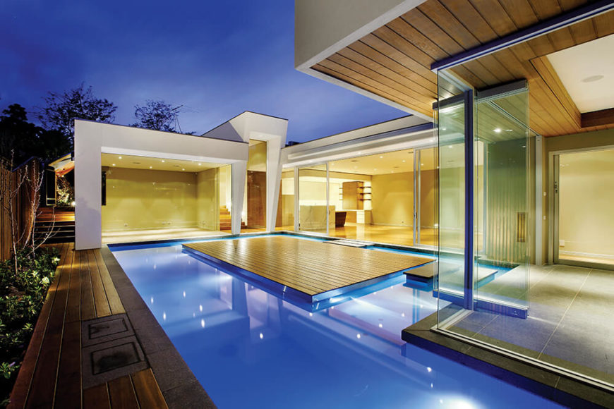 Gazing across the intricately designed pool, we see the complex interplay of light, glass, and hardwood. This mixture creates a constantly shifting palette, a feast for all senses.