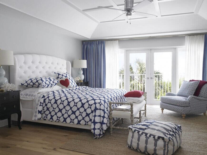 This bedroom has a very chic button-tufted headboard with a flawless snow white color scheme. A midnight blue color accents the rest of the room for a quaint look.