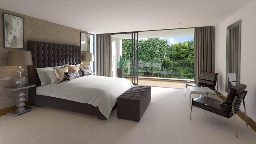 This contemporary bedroom has hints of gold throughout. A large button-tufted headboard creates a rich brown contrast with the hints of gold and cream.