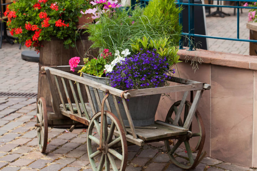 This charming wooden wagon, coupled with the galvanized tub gives this display a flair of cottage chic.
