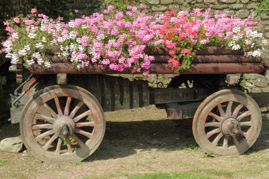 This wooden farm equipment makes for a rustic, charming, and large planter.