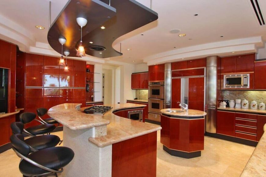 This Modern Kitchen Is Highlighted With Bold Red Wood Cabinetry Throughout,  Contrasting With Beige Tile