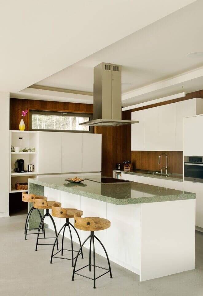 Superbe This Brightly Lit, Open, Yet Slim Kitchen Features Pristine White Cabinetry  And Rich Wood