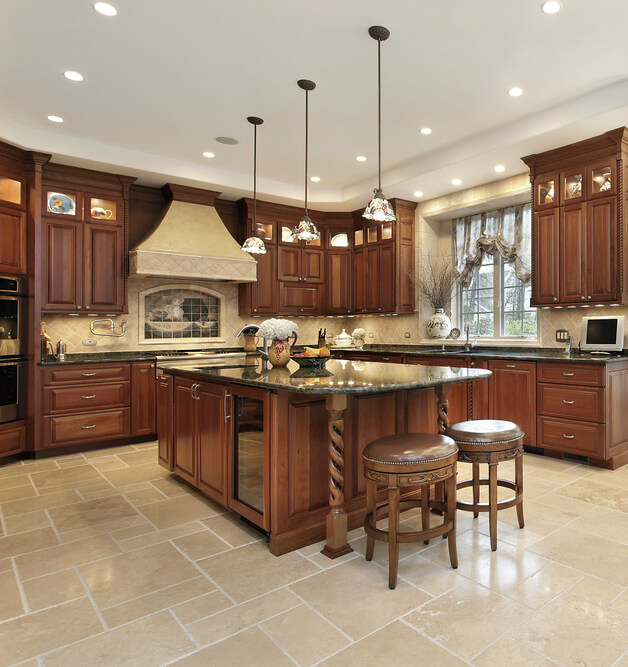 In A Richly Appointed, Traditionally Styled Dark Wood Kitchen, A Matching  Island Commands Attention