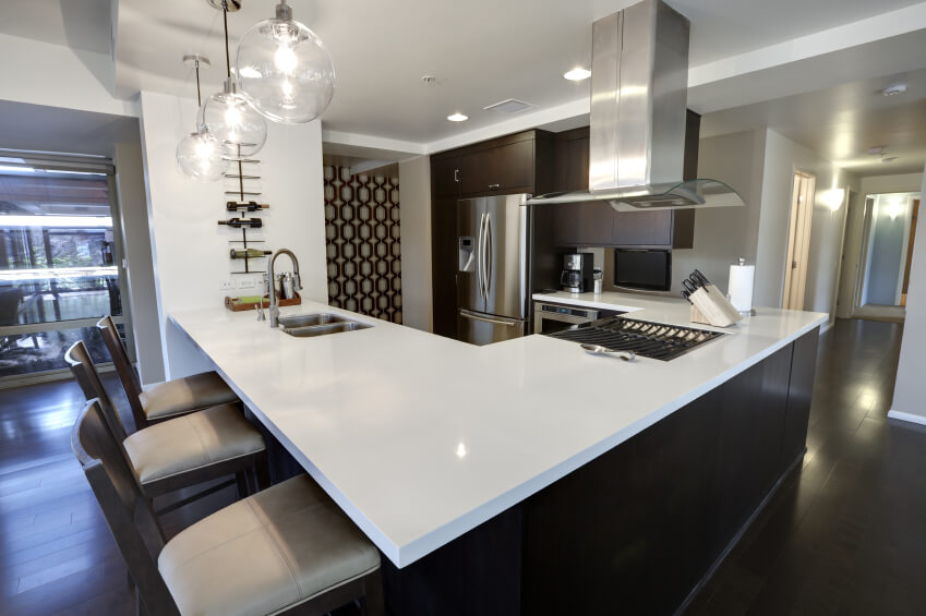 This Sleekly Contemporary Kitchen Sports Dark Hardwood Flooring And  Cabinetry Tones To Match, With A