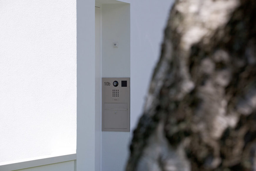 The security and mailbox were also considered when designing the facade and mimic the clean, simple lines of the house.