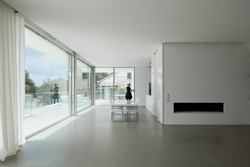 Stunning views are offered though the panoramic windows and bring in light helping obtain the loft feeling the occupants had requested and countering the closed, boxy feel of the front of the house.