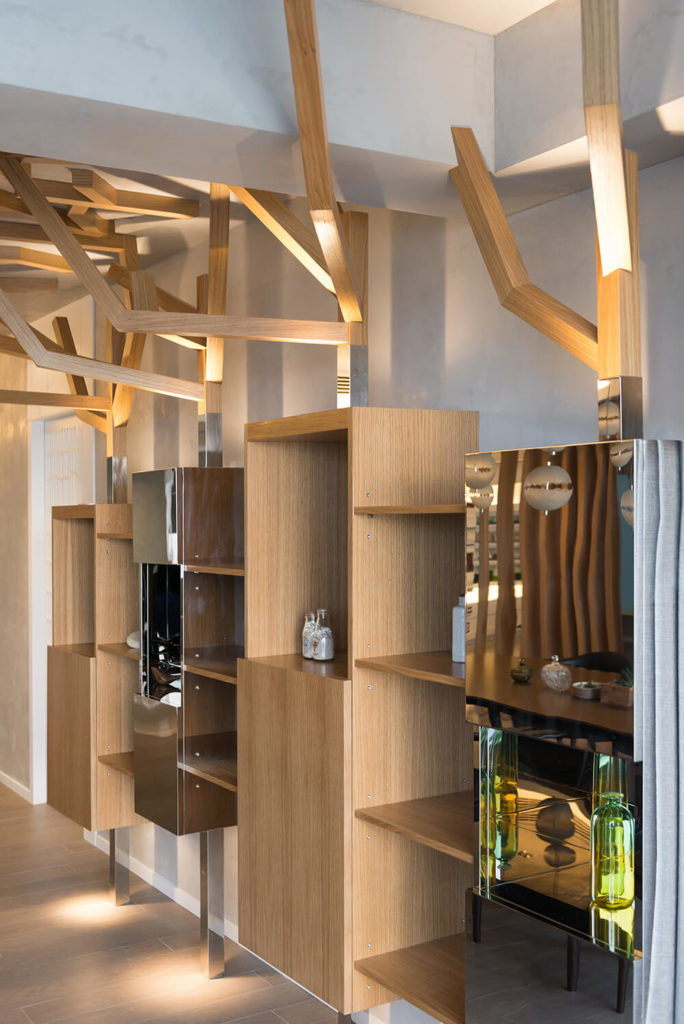 The key feature of the dining room is the storage. Each unit is meant to mimic the appearance of tree trunks which then flow up into the branches the spread across the ceiling.