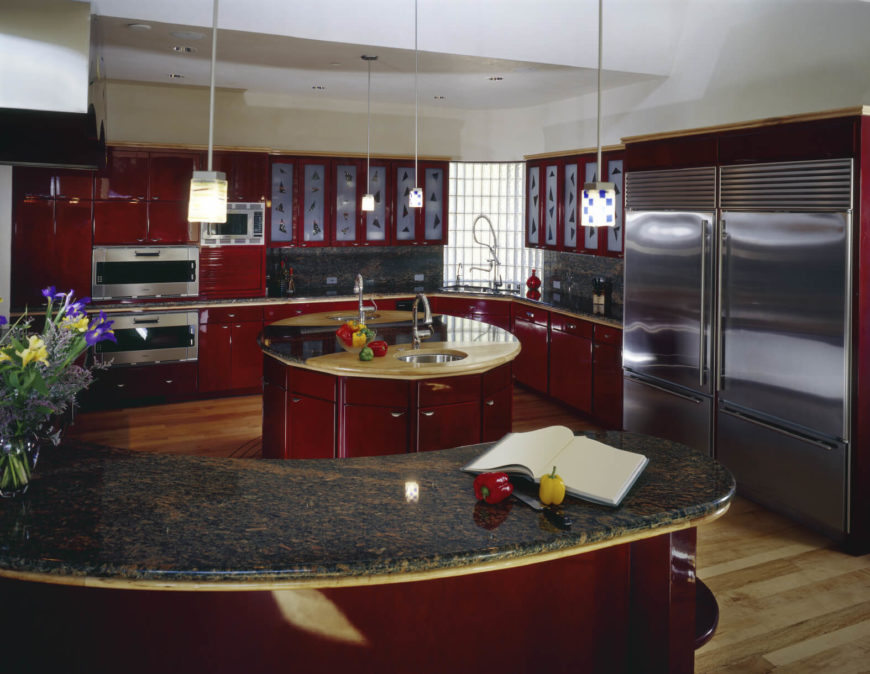 In A Modern Kitchen Flush With Bold Red Cabinetry, An Innovative Circular  Island Holds The