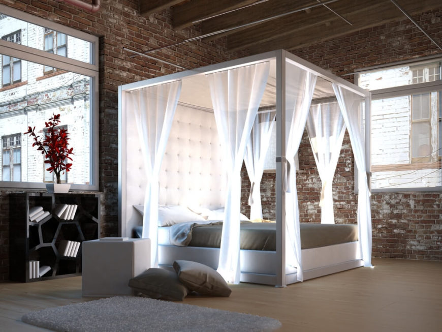 While the exposed brick and metalwork throughout this space gives it an industrial air, the button-tufted headboard and light, sheer white drapes add a softer element into the room.
