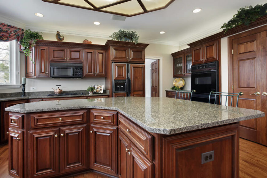 Charming A Richer Tone Of Wood Combined With Light Gray Granite Countertops Makes  For A Stunning Contemporary