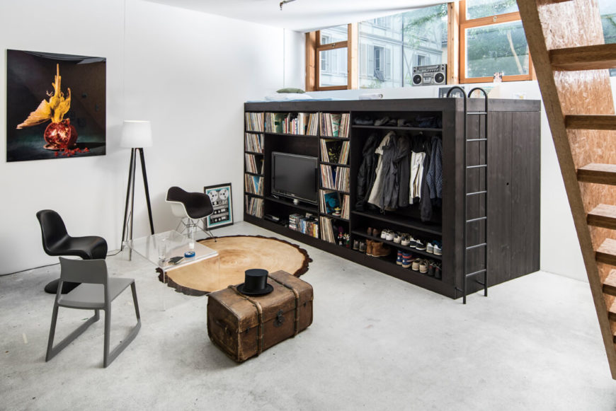 This fun Living Cube has everything you need for minimalistic living! With an entertainment center, closet, and bed all in one piece, you won't need anything else!