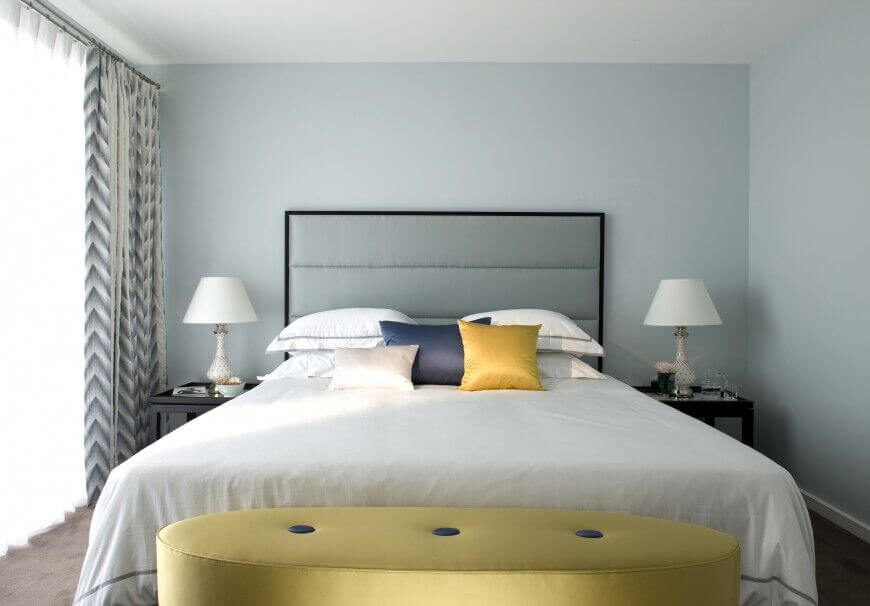 Beau A Minimalist Bedroom With A Chic Colored Headboard, Walls, And Bed Linens  To Create