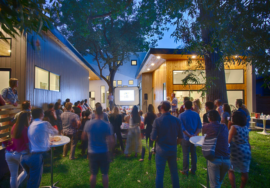 Here we see the courtyard in full bloom, with its intended purpose as a venue for gatherings and performances. The home practically hugs this cozy outdoor space.