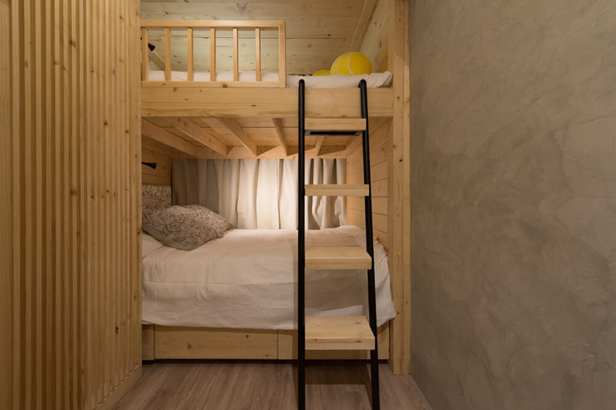 The bunk bed structure in the bedroom is a large natural wood structure and, like the rest of the home, can be configured in multiple ways.