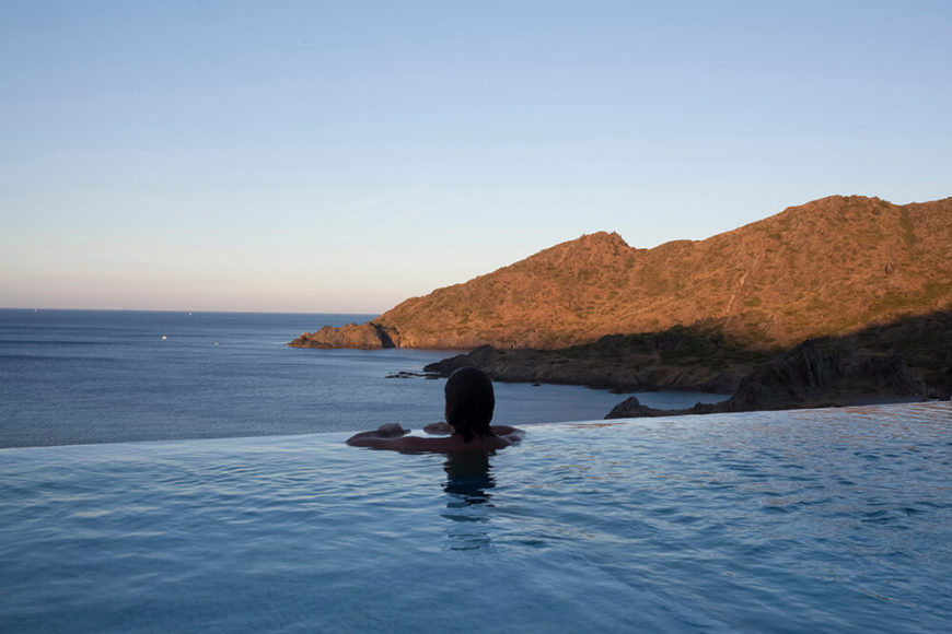 We move outside to the infinity pool. The appeal of an infinity pool is perfectly illustrated by this image. The pool appears to continue over the edge and onto the horizon.