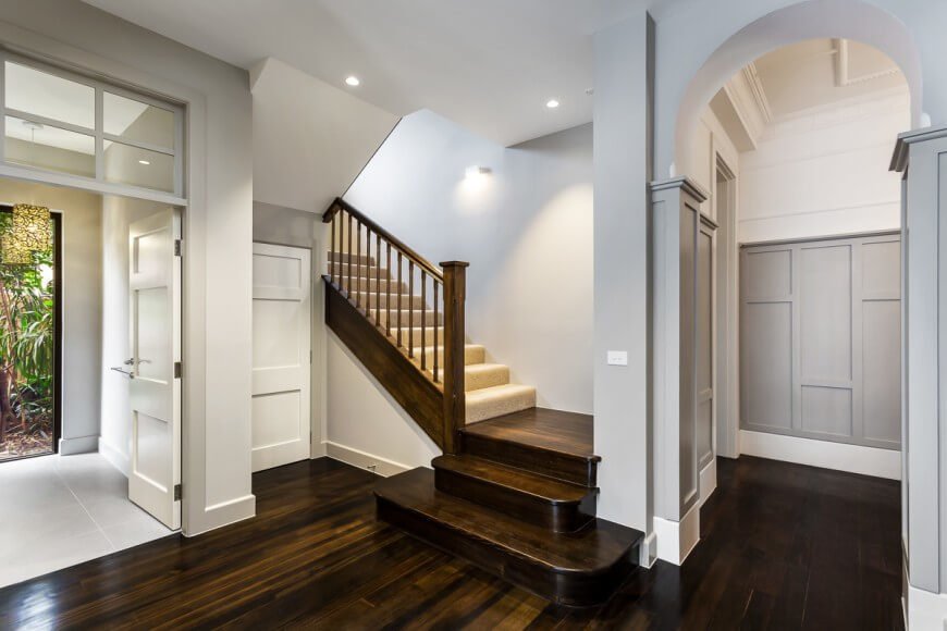 This is a view from further into the main foyer. The gorgeous wood floor continues further into the house and up the stairs. The backdoor opens up to a small foyer that leads out into the backyard.
