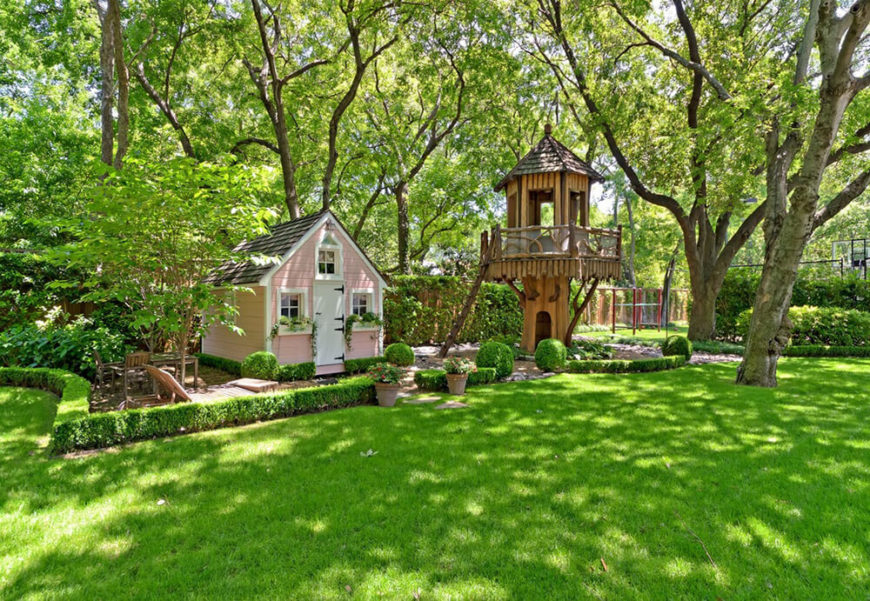A Small Fairy Cottage Has Its Own Garden And Landscaping, With A Treehouse  Tower Off