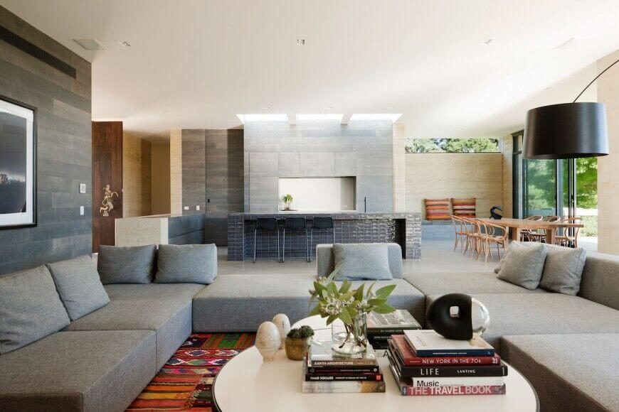 The smooth lines and textures of this contemporary open-concept home are subtle decoration that allows each individual section of the space to shine on its own merit.