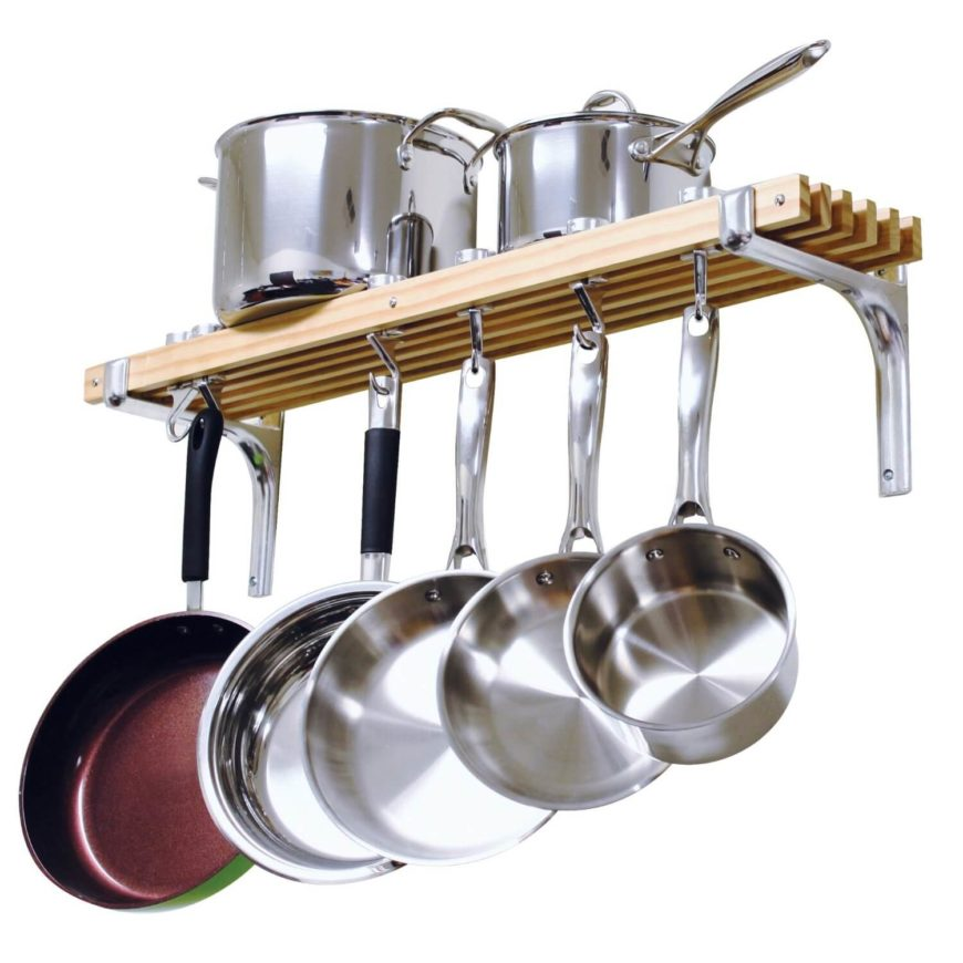 This standard wall-mounted pot rack allows you to hang your skillets from the hooks, while stacking your larger stock pots and pans on the shelf.