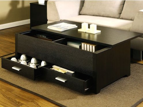 There are drawers in the bottom of the table, and the top is also removable, revealing two storage cubbies