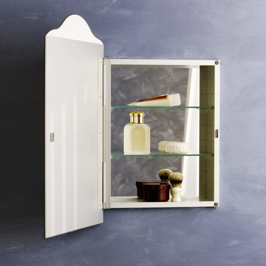 The front is much larger than the inside, so you get a sleek, arched mirror with a hidden inside. The cabinet is inset into the wall, so your mirror will look flush to the wall.
