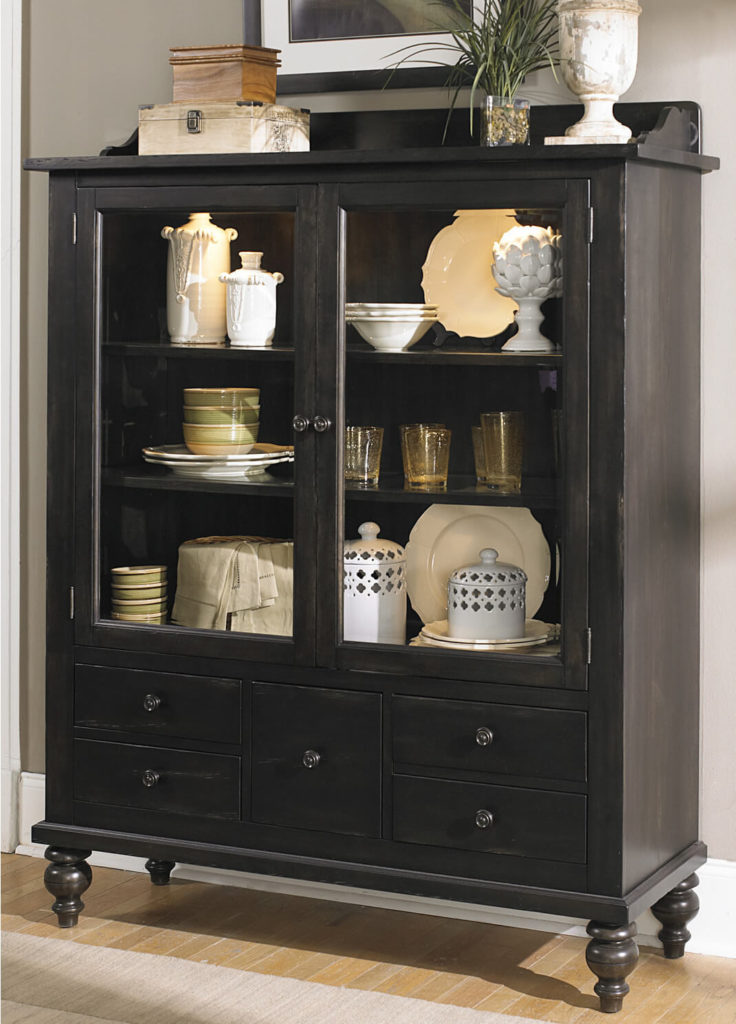 The lower drawers are perfect for storing silverware or linens, while more delicate pieces are arranged in on the shelves above.