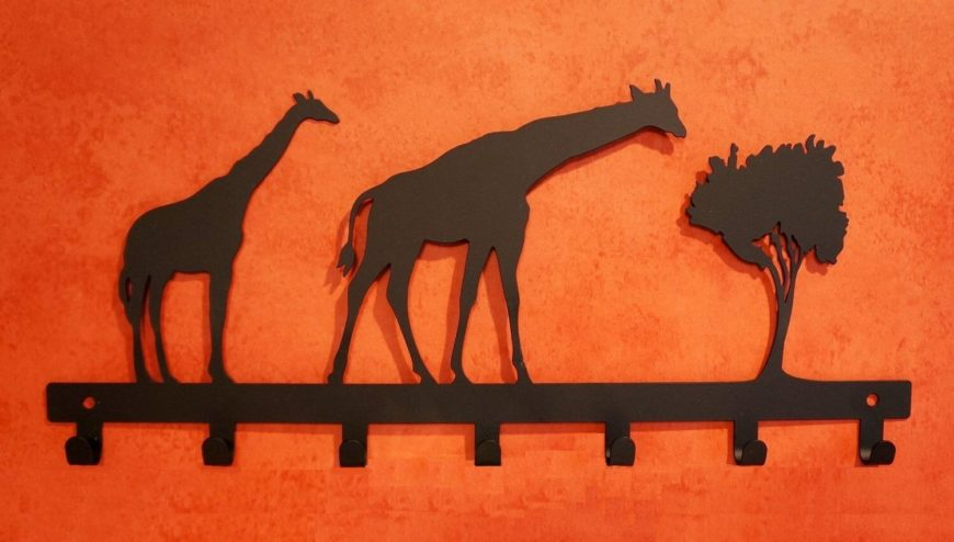 This safari-themed wall-mounted coat rack will do the job nicely. Sturdy, deep hooks will ensure your coats won't end up on the floor.
