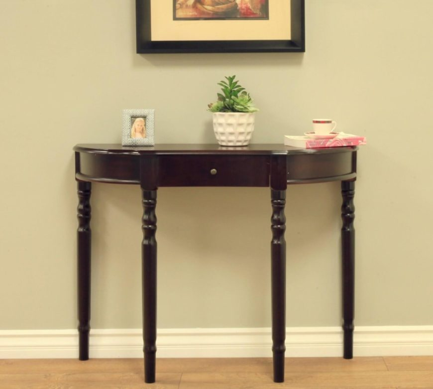 This Half Circle Table Has A Single Drawer And Is In A Rich Dark Wood