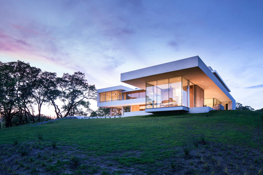 Modern home built on a vineyard, with double height glazing for natural lighting and open design.