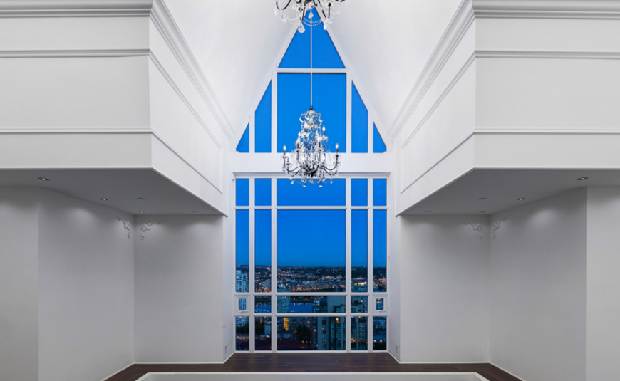 The third floor vaulted ceiling that started in the library on the first floor. This small balcony area opens into the master bedroom while the expansive window gives a stunning view of the city and allows for plenty of bright light during the day.