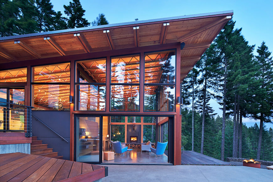 Large sliding windows open up to the deck and patio beyond creating a great space for entertaining. The goal of including as much access as possible to the surrounding nature is greatly achieved here.