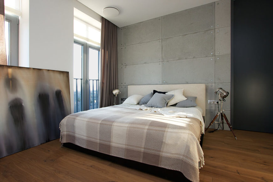 Moving into the master bedroom, we can see the unique, individual style of the occupant. Minimalist and industrial, yet softer details balance out the rougher ones and adds visual interest. We particularly love the bedside lamps.