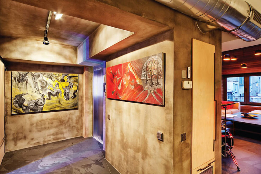 Artwork plays a prominent role in the home, spiking the neutral, natural, and industrial framework with color and passion. These pieces add a splash of energy and emotion to the utilitarian space.