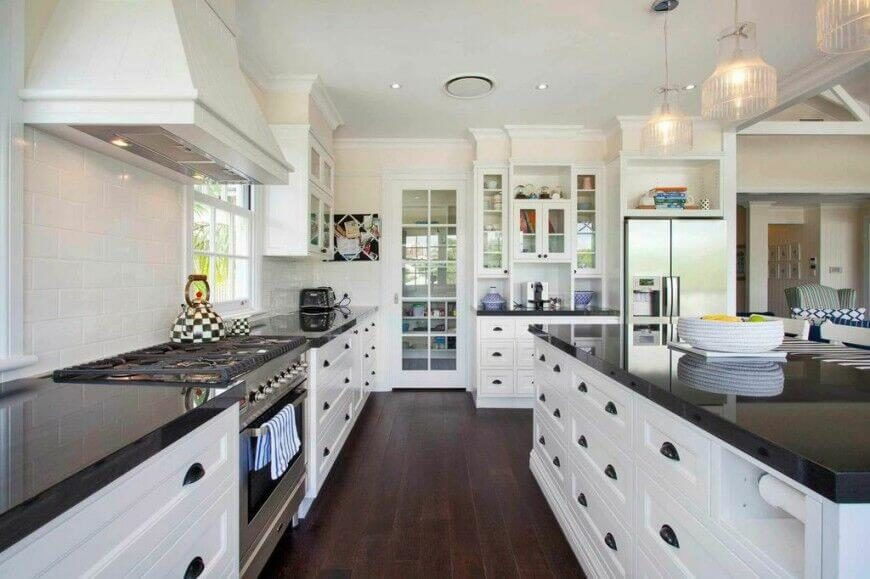 white kitchen cabinets and black countertops