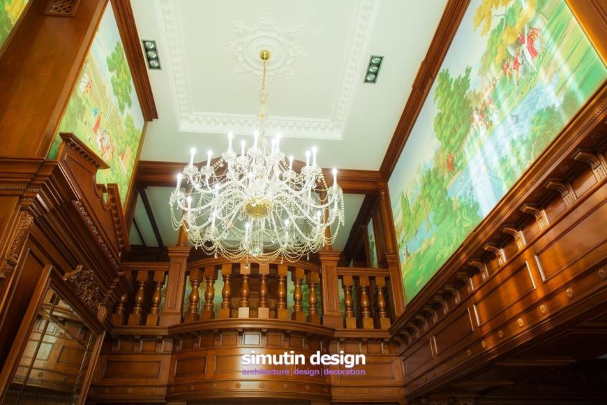 A closer look at the top of the room reveals the absolutely stunning woodwork and murals. The chandelier hooks into a large medallion in the center of the tray ceiling.