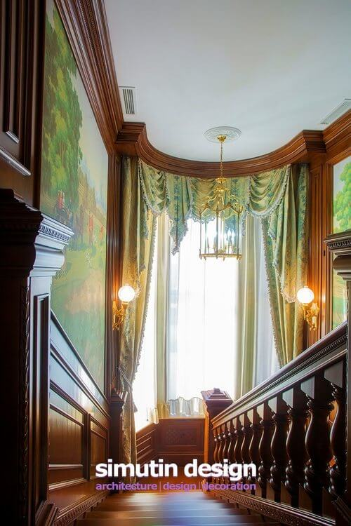 As we look down the stairs from the top, we are presented with an enormous bay window with antique globe lights on either side. A simple light fixture hangs from the tall ceilings. The windows are framed on either side by giant pastoral murals.